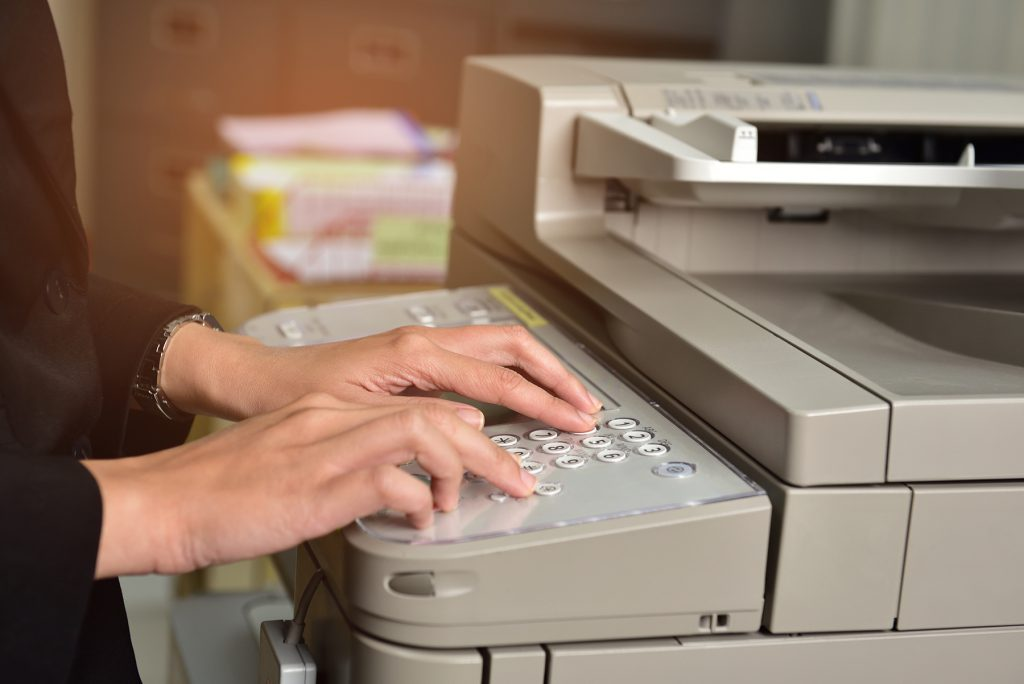 Office employee making document copies